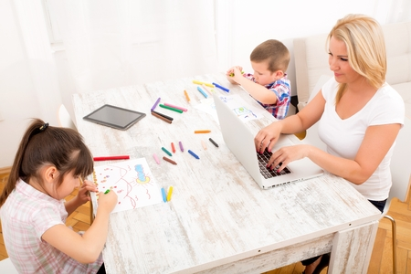 Photo for Mom working at home - Royalty Free Image