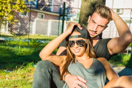Photo pour A young HipHop styled couple standing during sunset in a urban environment. - image libre de droit