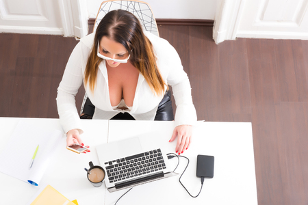 Photo pour Big and Beautiful Secretary working in a office - image libre de droit