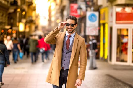 Photo for An elegant man walking on the streets. - Royalty Free Image