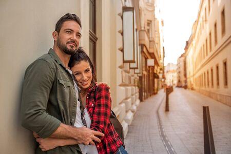 Photo pour A couple in love hugging each other in a European city.. - image libre de droit