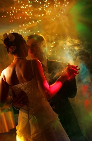 Newlywed couple dancing at their wedding reception.