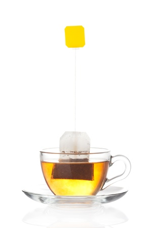 Cup of tea with tea bag  blank label  inside isolated on white background