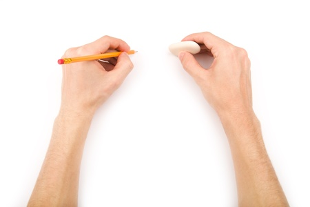 Left-handed person with pencil and eraser