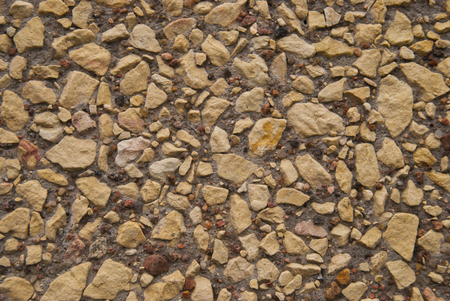 Photo for Little Grey Brown Minerals Rocks  Background. Gravel Stones at sunny day. Decorative elements on the wall - Royalty Free Image
