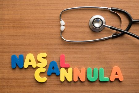 Nasal cannula colorful word with stethoscope on the wooden background