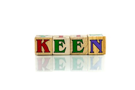 keen colorful wooden word block on the white background
