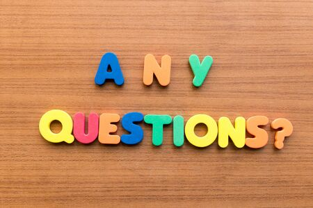 any questions  colorful words on the wooden background