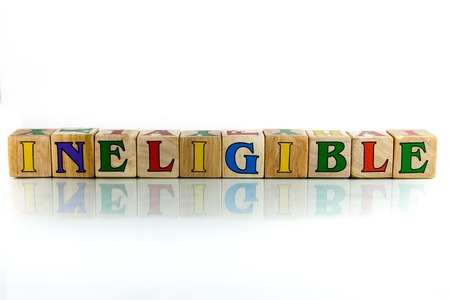ineligible colorful wooden word block on the white background