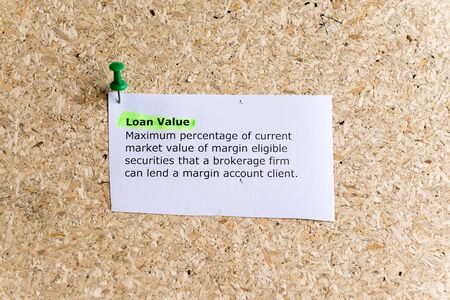 loan value word typed on a paper and pinned to a cork notice board