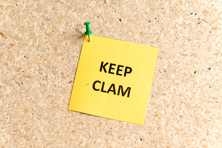 keep clam word typed on a paper and pinned to a cork notice board