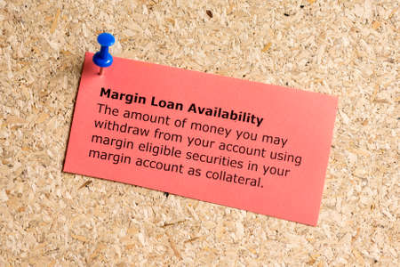 Margin loan availibility word typed on a paper and pinned to a cork notice board