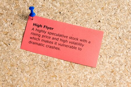 high flyer word typed on a paper and pinned to a cork notice board