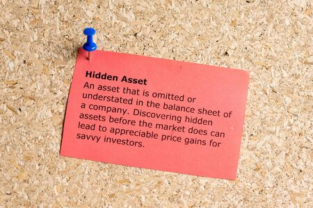 hidden asset word typed on a paper and pinned to a cork notice board