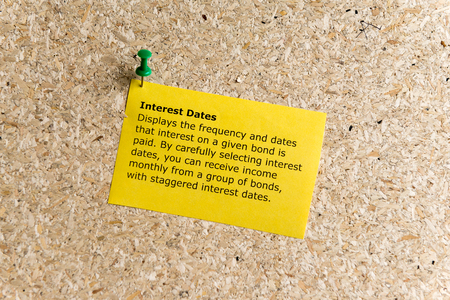 interest dates word typed on a paper and pinned to a cork notice board