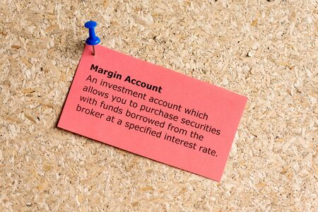 margin account word typed on a paper and pinned to a cork notice board