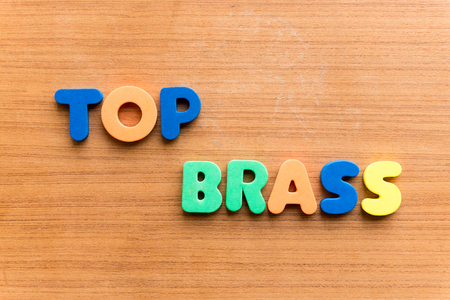 top brass colorful word on the wooden background