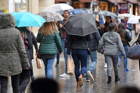Many umbrellas in a pedestrian zone in Munich (Germany) - Many umbrellas in a pedestrian zone in Munich (Germany)