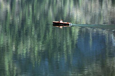 Photo pour A boat on Lake Hallstatt in the Salzkammergut, Austria, Europe - image libre de droit
