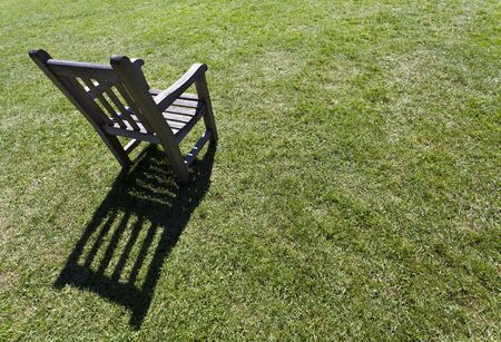 garden chair on the green meadow