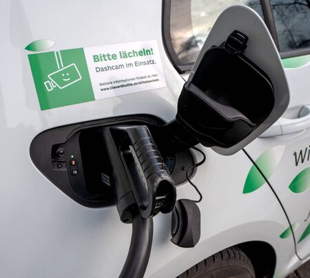 Photo for Refueling an electric car with electricity - Royalty Free Image