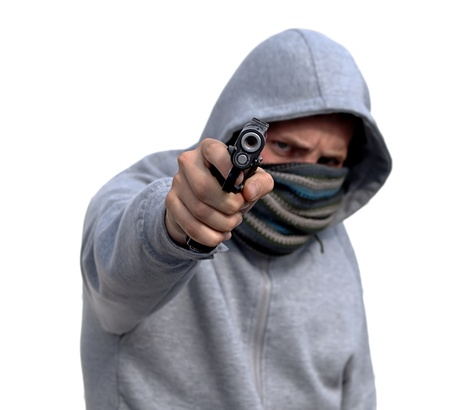Youth with hoody pointing handgun isolated on white