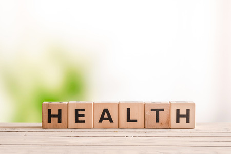 Photo for Health sign made of wood on a natural desk - Royalty Free Image