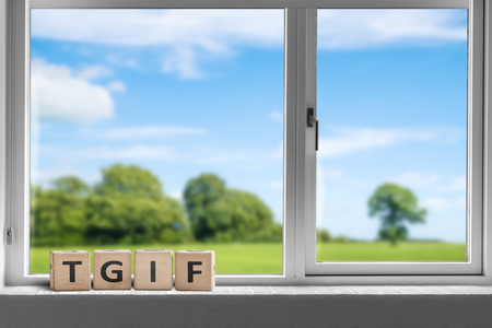 Photo pour TGIF weekend sign in a white window with a view to sunshine over a beautiful landscape - image libre de droit
