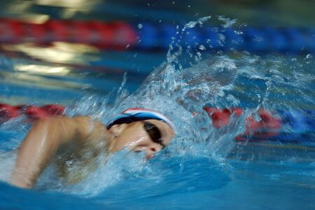 A freestyle swimmer in action.