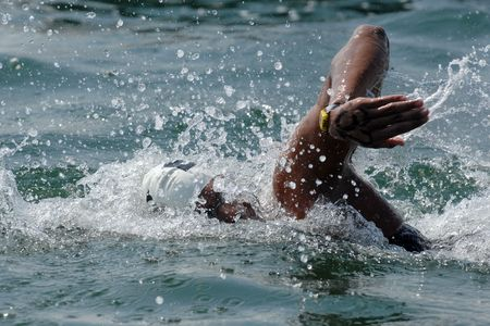 An openwater swimmer races to the finish line.