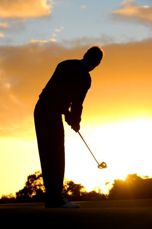 A male golfer enjoys an early round