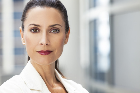 Outdoor portrait of a beautiful smart middle aged brunette woman or businesswoman