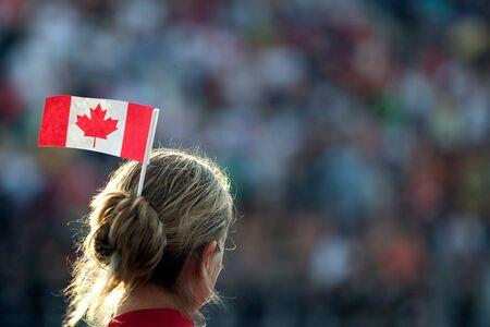 London Ontario, Canada - July 2010. A person with a small Canadian flag in her hair at the opening ceremonies of the 2010 Special Olympics Canada Summer Games.