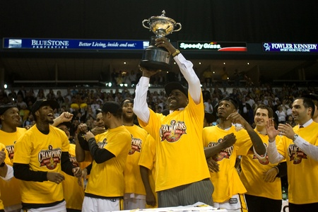 London Ontario, Canada - March 25, 2012. London Lightning coach and NBL Coach of the Year Michael Ray Richardson hoists the leagues championship trophy. The London Lightning defeated the Halifax Rainmen 116-92 in the fifth and deciding game to win the Nat
