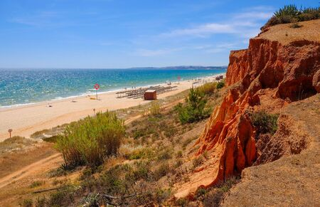 FALESIA, ALGARVE, PORTUGAL - MAI 25, 2019: View on the beach Praia da Rocha Baixinha Nascente with beautiful red sandstone cliffs and golden sand.