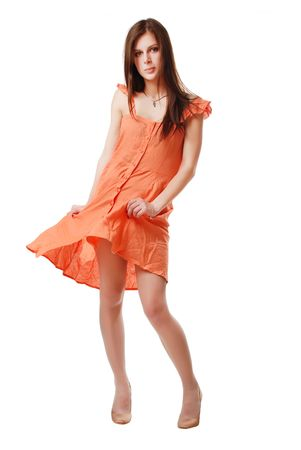 brunette girl in the orange dress isolated on a white background