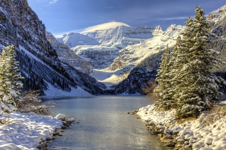 Early winter snow settles on Lake Louise Alberta in the Canadian Rockies