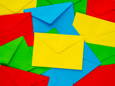 colorful cover letter background. Multi colored envelopes and letters as a background