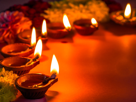 Photo for Traditional clay diya lamps lit with flowers for Diwali festival celebration. - Royalty Free Image