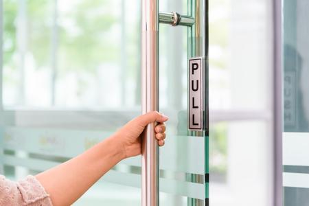 Foto de Closeup women hand open the door knob . - Imagen libre de derechos