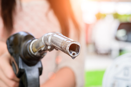 Photo for Woman pumping gasoline fuel in car at gas station. - Royalty Free Image