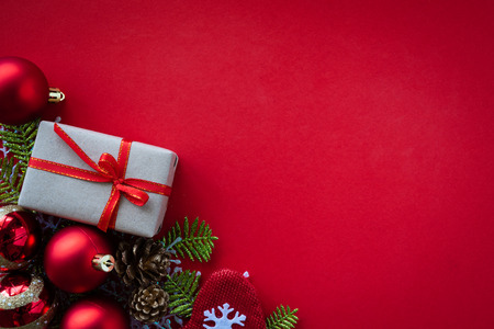 Photo for Christmas background concept. Christmas gift box, pine cones, fir branches, red ball, golden star, red socks on red background. - Royalty Free Image
