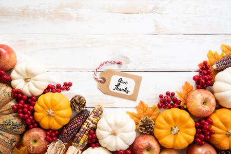 Photo for Top view of  Autumn maple leaves with Pumpkin and red berries on white wooden background. Thanksgiving day concept. - Royalty Free Image