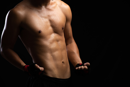 Photo pour Closeup of a strength fitness body. Fit young man with beautiful torso. Bodybuilder and muscular body concept. - image libre de droit