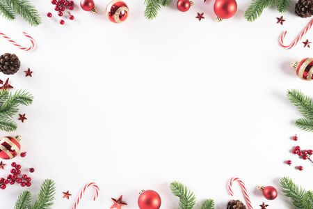 Photo for Christmas background concept. Top view of Christmas green gift box with candy cane, snowflakes, red berries and bell on white wooden background. - Royalty Free Image