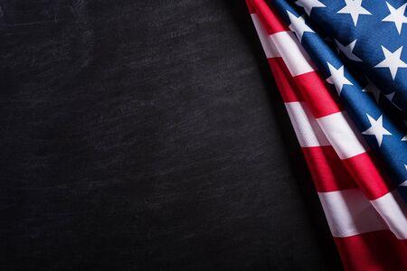 Photo pour Happy Veterans Day. American flags veterans against a blackboard background. - image libre de droit