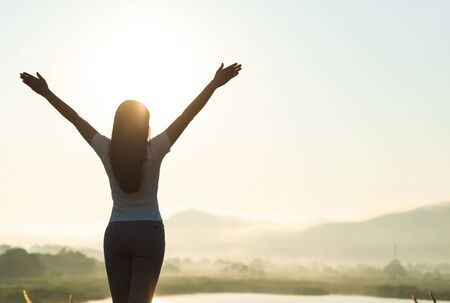 Photo pour Silhouette of happy woman spreading arms and watching the mountain. Travel Lifestyle success concept adventure active vacations outdoor freedom emotions. - image libre de droit
