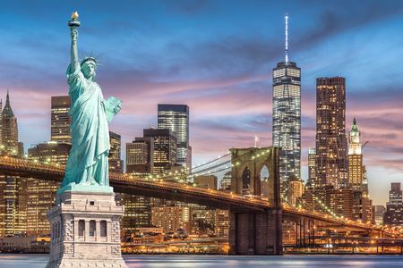 Photo pour The Statue of Liberty and Brooklyn Bridge with World Trade Center background twilight sunset view, Landmarks of New York City, USA - image libre de droit