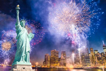 Foto de The Statue of Liberty with blurred background of cityscape with beautiful fireworks at night, Manhattan, New York City, USA - Imagen libre de derechos