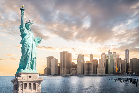 Foto de The Statue of Liberty with Lower Manhattan background in the evening at sunset, Landmarks of New York City, USA - Imagen libre de derechos